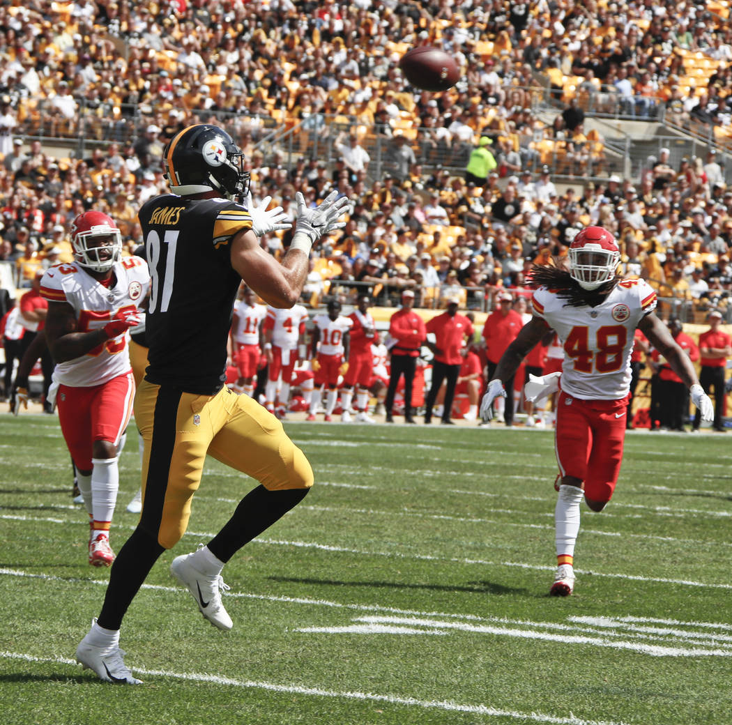 Pittsburgh Steelers tight end Jesse James (81) makes a catch for a touchdown past Kansas City Chiefs linebacker Terrance Smith (48) in the first half of an NFL football game, Sunday, Sept. 16, 201 ...