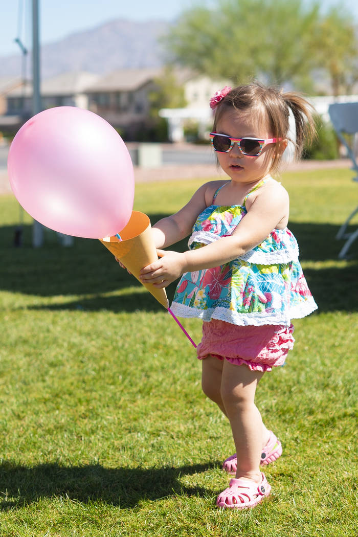 Piper Daniel, 1, walks through Huckleberry Park with a balloon ice cream cone at the annual Sunny 106.5 Ice Cream Sunday event in Las Vegas, Sunday, Sept. 16, 2018. (Marcus Villagran/Las Vegas Rev ...
