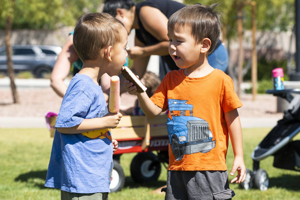 From left, Twins Eli Man, 4, and Flynn Man, 4, share ice cream at the annual Sunny 106.5 Ice Cream Sunday event at Huckleberry Park in Las Vegas, Sunday, Sept. 16, 2018. (Marcus Villagran/Las Vega ...
