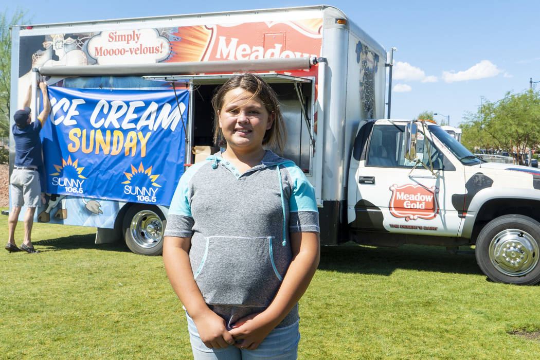 Josephine Jenks, 12, winner of the first youth ice cream eating contest of the day poses for a photograph after her victory at the annual Sunny 106.5 Ice Cream Sunday event at Huckleberry Park in ...