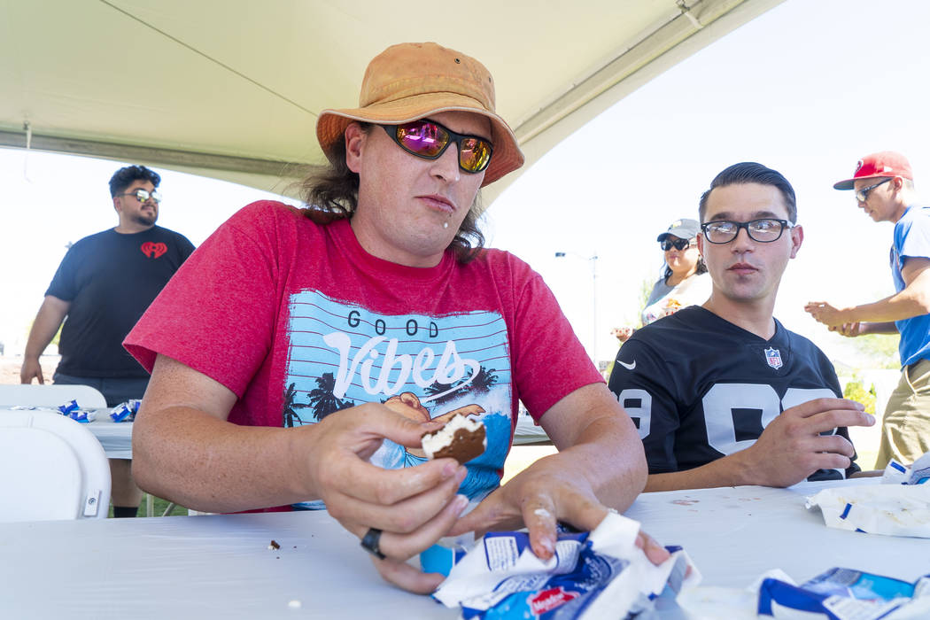 Travis Henry competes in the first adult ice cream eating contest of the day at the annual Sunny 106.5 Ice Cream Sunday event at Huckleberry Park in Las Vegas, Sunday, Sept. 16, 2018. (Marcus Vill ...