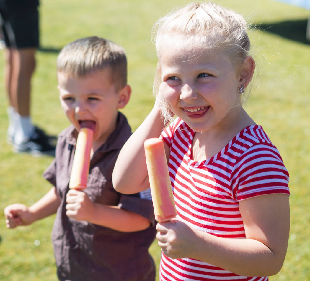 Zane Huth, 3, left, eats ice cream with his sister Ivy Huth, 6, at the annual Sunny 106.5 Ice Cream Sunday event at Huckleberry Park in Las Vegas, Sunday, Sept. 16, 2018. (Marcus Villagran/Las Veg ...