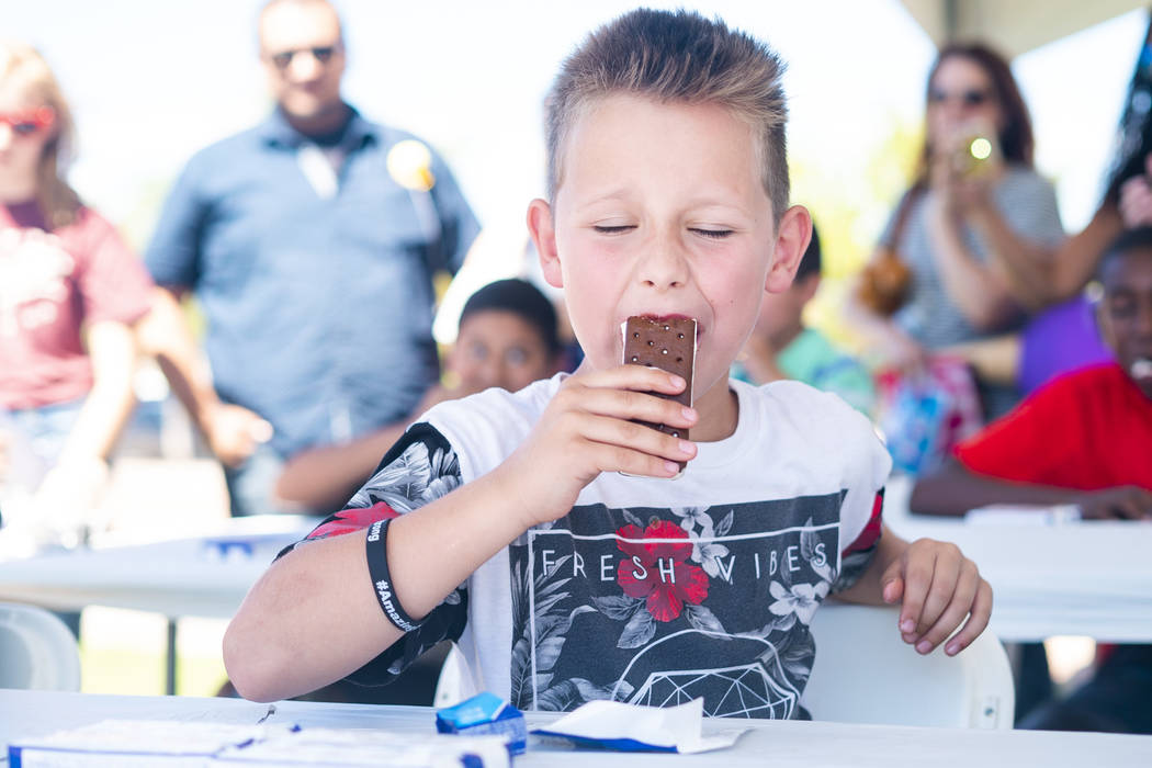 Dillan Crager, 10, participates in the second youth ice cream eating contest of the day at the annual Sunny 106.5 Ice Cream Sunday event at Huckleberry Park in Las Vegas, Sunday, Sept. 16, 2018. ( ...