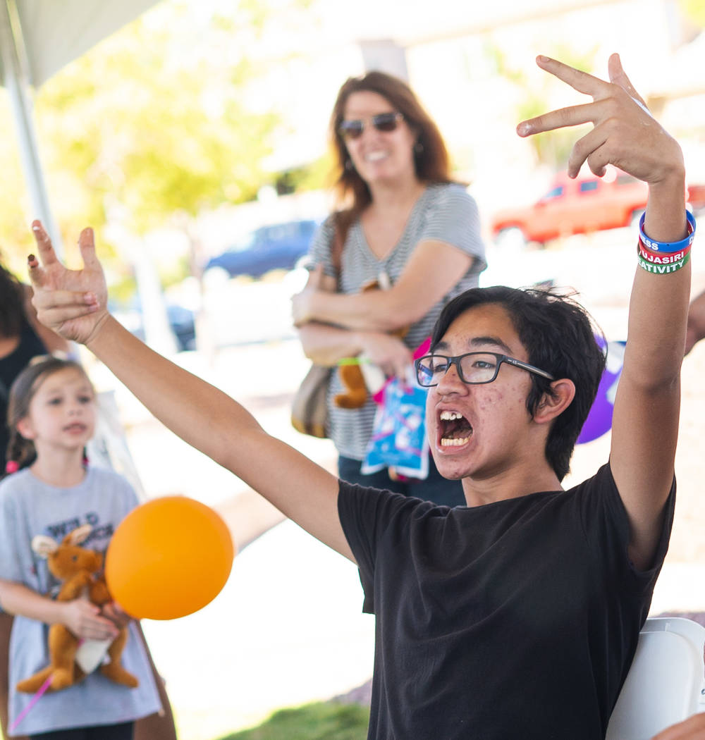 Jonathan T., 13, celebrates after winning the second youth ice cream eating contest of the day in the annual Sunny 106.5 Ice Cream Sunday event at Huckleberry Park in Las Vegas, Sunday, Sept. 16, ...