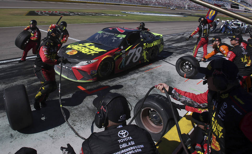 Martin Truex Jr. pits during a NASCAR Cup Series auto race Sunday, Sept. 16, 2018, in Las Vegas. (AP Photo/Isaac Brekken)
