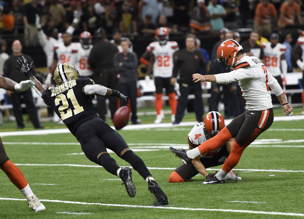 Cleveland Browns kicker Zane Gonzalez (2) tries for an extra point as New Orleans Saints defensive back Patrick Robinson (21) defends during the second half of an NFL football game in New Orleans, ...