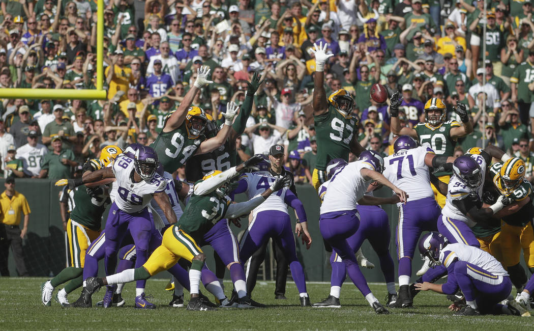 Minnesota Vikings' Daniel Carlson misses a field goal during overtime an NFL football game against the Green Bay Packers Sunday, Sept. 16, 2018, in Green Bay, Wis. The game ended in a 29-29 tie. ( ...