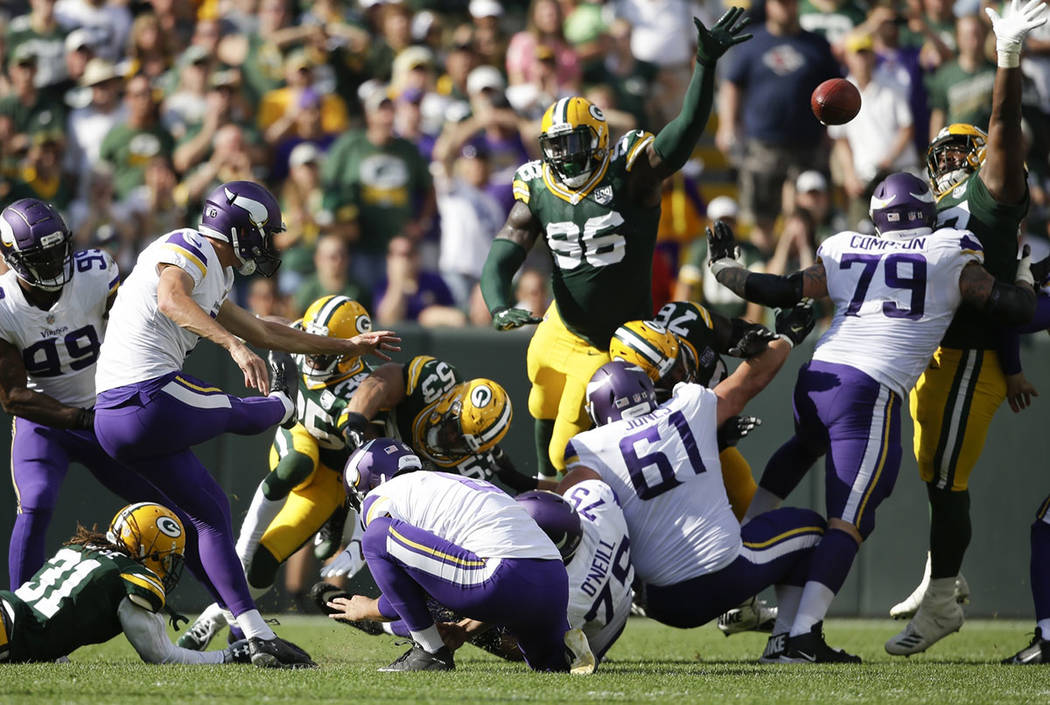 Minnesota Vikings kicker Daniel Carlson misses a field goal in the final sends of overtime an NFL football game against the Green Bay Packers Sunday, Sept. 16, 2018, in Green Bay, Wis. The game en ...