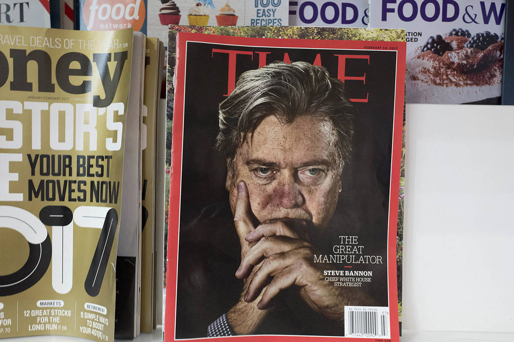 An issue of Time magazine is displayed on a New York newsstand. (AP Photo/Mark Lennihan)