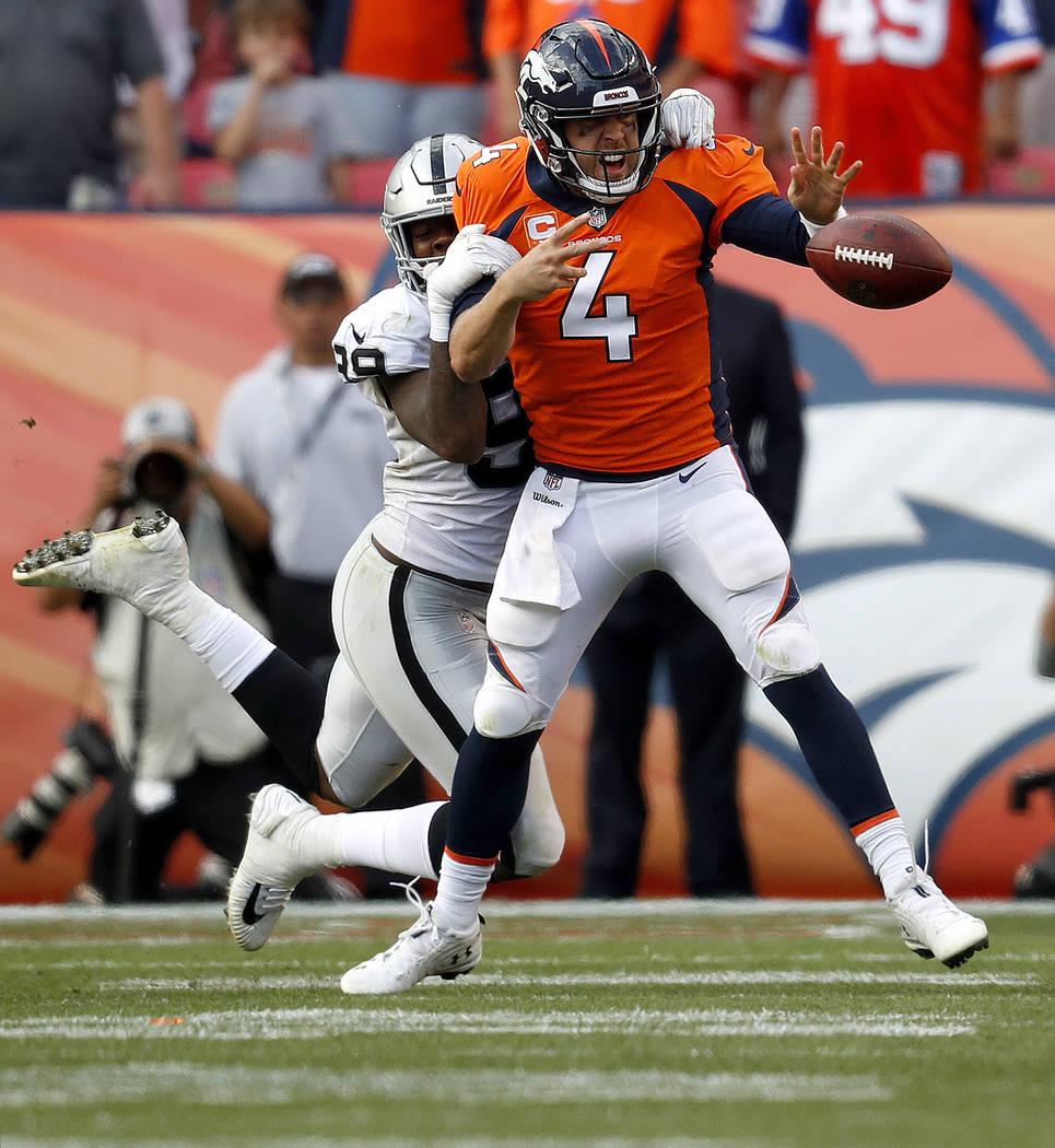 Denver Broncos quarterback Case Keenum (4) fumbles under pressure from Oakland Raiders defensive end Arden Key (99) during the second half of an NFL football game, Sunday, Sept. 16, 2018, in Denve ...