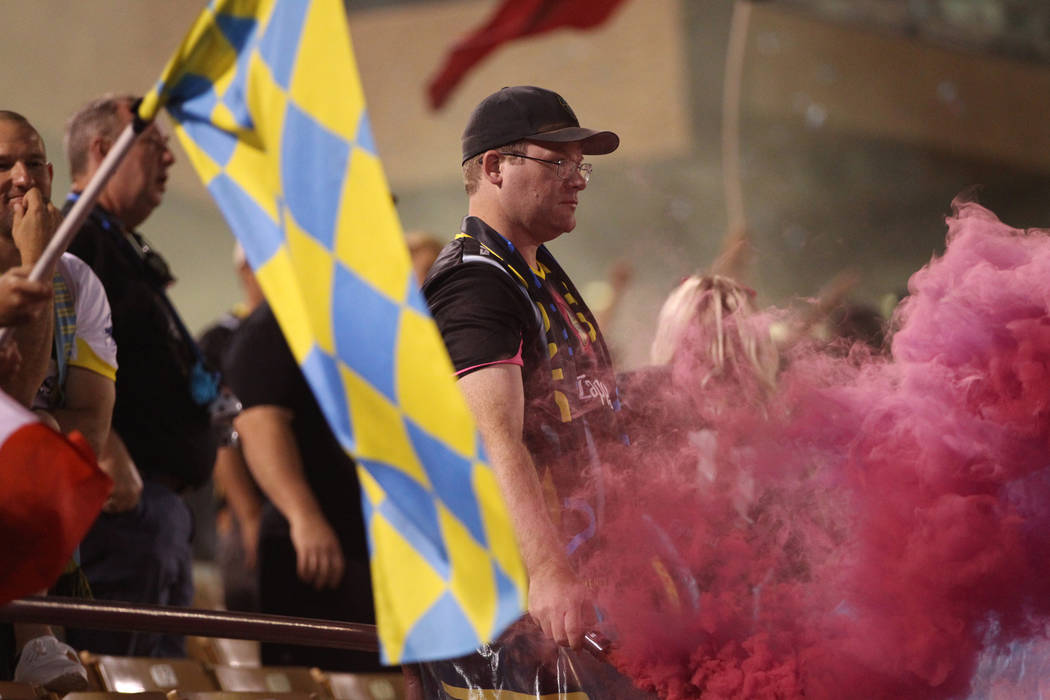 A fan holds a smoke bomb during a soccer game between the Las Vegas Lights and the Portland Timbers at Cashman Field in Las Vegas, Sunday, Sept. 16, 2018.The Las Vegas Lights lost 2-0. Erik ...