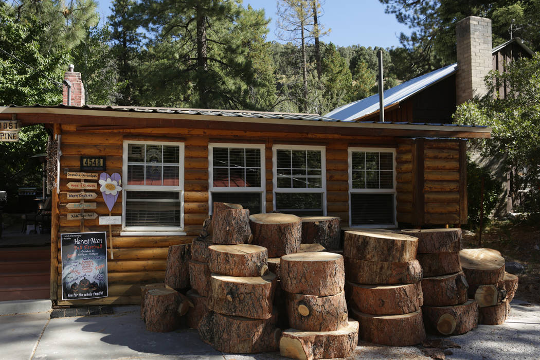 Rounds from a 100-foot-tall Ponderosa pine that was estimated to be 300-years-old lie stacked in front of the Mount Charleston home of Rose Meranto on Monday, September 17, 2018, after she was for ...