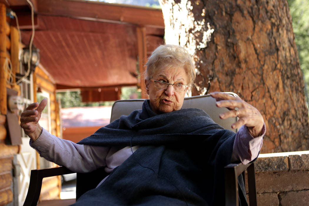 Rose Meranto sits in front of the stump of a Ponderosa pine that was estimated to be 100-feet-tall and 300-years-old that was growing next to her Mount Charleston until she was forced to to cut th ...