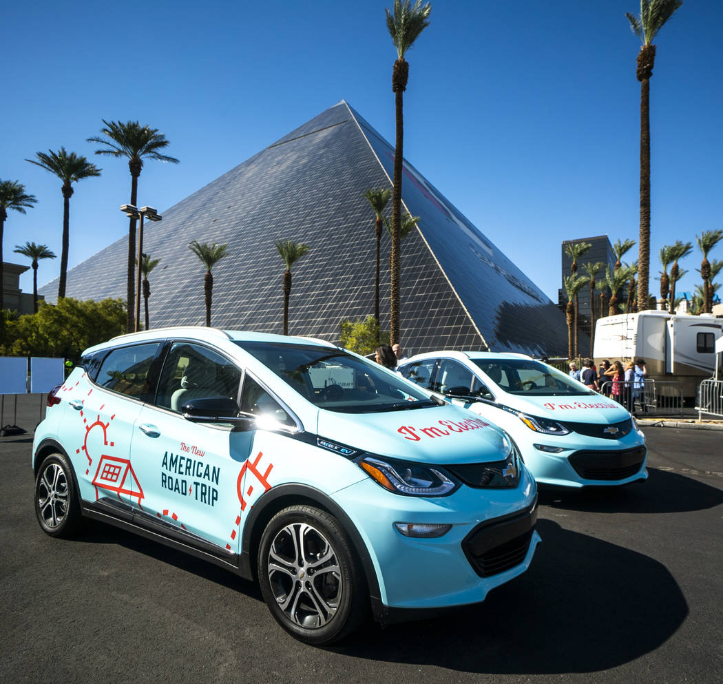 """""""The New American Road Trip,"""" an electric-vehicle tour from California to New York, made a stop in front of the Luxor casino-hotel in Las Vegas, Sunday, Sept. 16, 2018. (Marcus Villagran ..."""