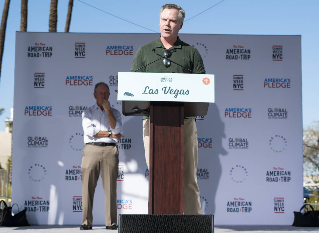 """MGM Resorts International CEO James Murren speaks in front of the Luxor casino-hotel in Las Vegas at an event for """"The New American Road Trip,"""" an electric-vehicle tour from California t ..."""