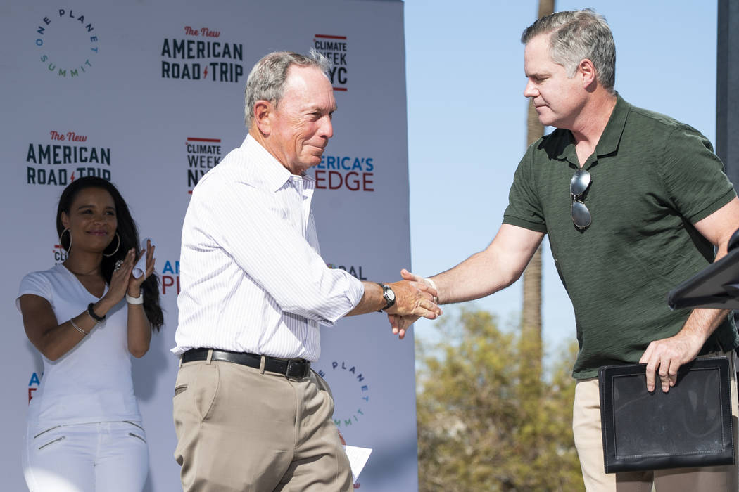 """Former New York City mayor Michael Bloomberg and MGM Resorts International CEO James Murren shake hands in front of the Luxor casino-hotel in Las Vegas during """"The New American Road Trip,&quo ..."""