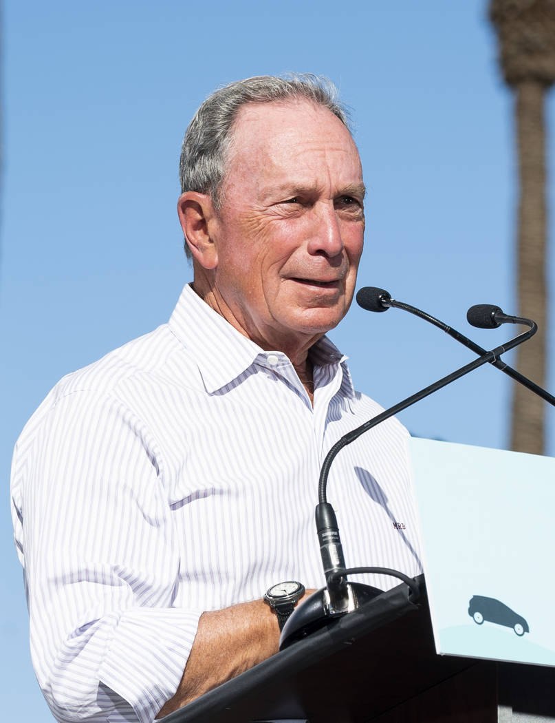 """Former New York City mayor Michael Bloomberg speaks in front of the Luxor hotel-casino in Las Vegas at an event for """"The New American Road Trip,"""" an electric-vehicle tour from California ..."""