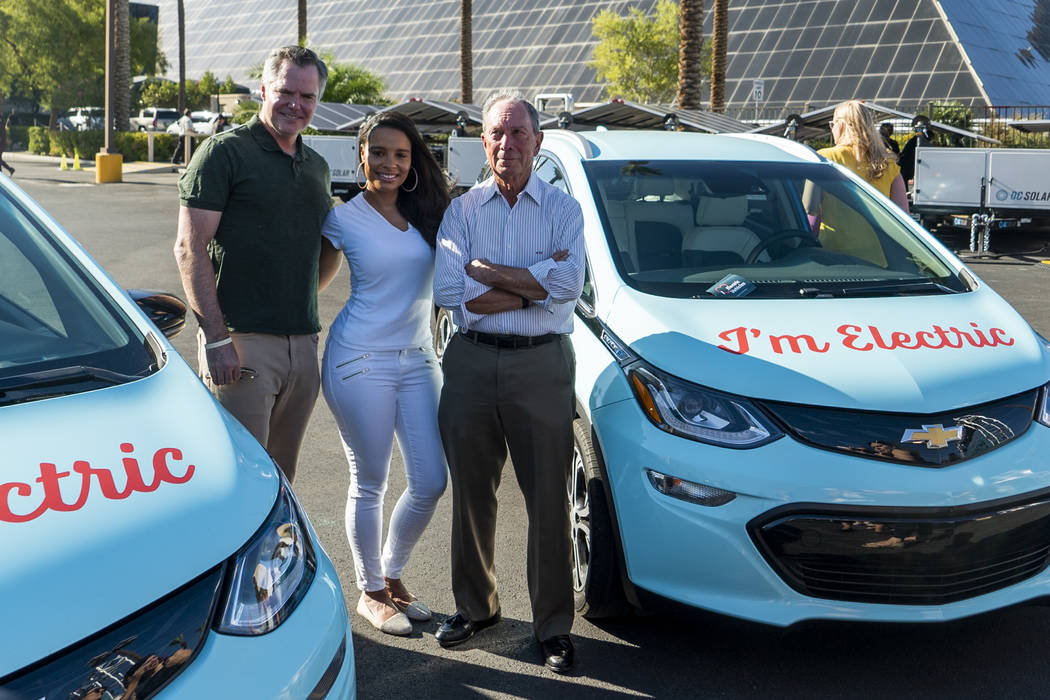 From left, MGM Resorts International CEO James Murren, American actress and singer Antonique Smith and former New York City mayor Michael Bloomberg pose next to electric vehicles in front of the L ...