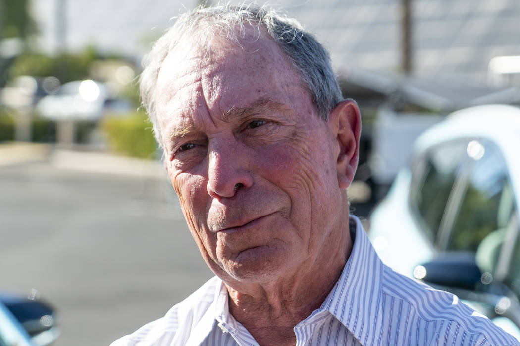 """Former New York City mayor Michael Bloomberg speaks with media in front of the Luxor hotel-casino in Las Vegas at """"The New American Road Trip,"""" an electric-vehicle tour from California t ..."""