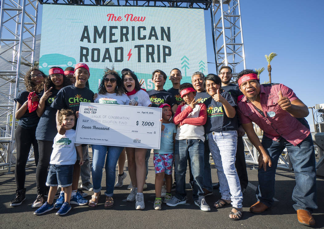 Members of Chispa, a conservation organization focused on replacing diesel school buses with electric school buses, pose for a photograph in front of the Luxor casino-hotel in Las Vegas after rece ...