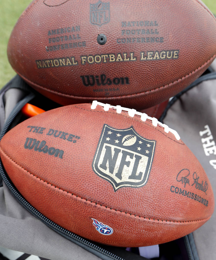 In this July 27, 2018, file photo, footballs sit on a sideline during a Tennessee Titans NFL football training camp practice, in Nashville, Tenn. (AP Photo/Mark Humphrey, File)