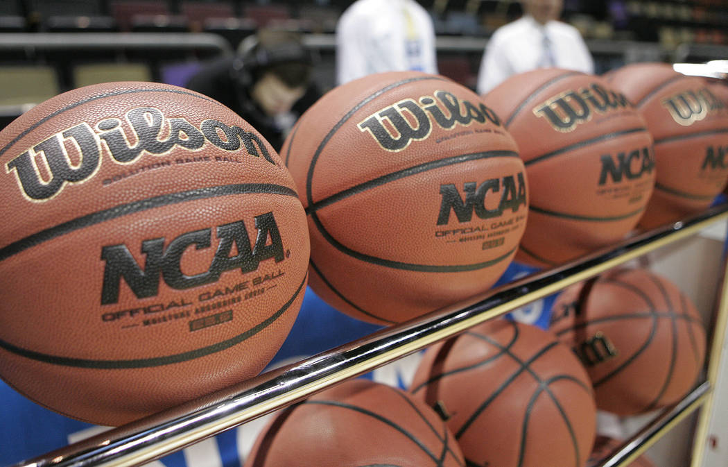 In this March 20, 2010, file photo, basketballs sit in a rack before an NCAA college basketball tournament first round game between Princeton and St. John's in Tallahassee, Fla. (AP Photo/Phil Coa ...