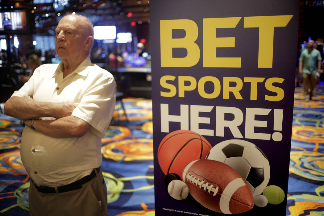 In this June 28, 2018, file photo, a sign advertising sports betting is displayed at Ocean Resort Casino in Atlantic City, N.J. (AP Photo/Seth Wenig, File)