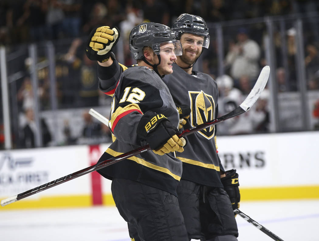 Golden Knights defenseman Erik Brannstrom (12) celebrates his goal with defenseman Colin Miller during the third period of a preseason NHL hockey game against the Arizona Coyotes at T-Mobile Arena ...