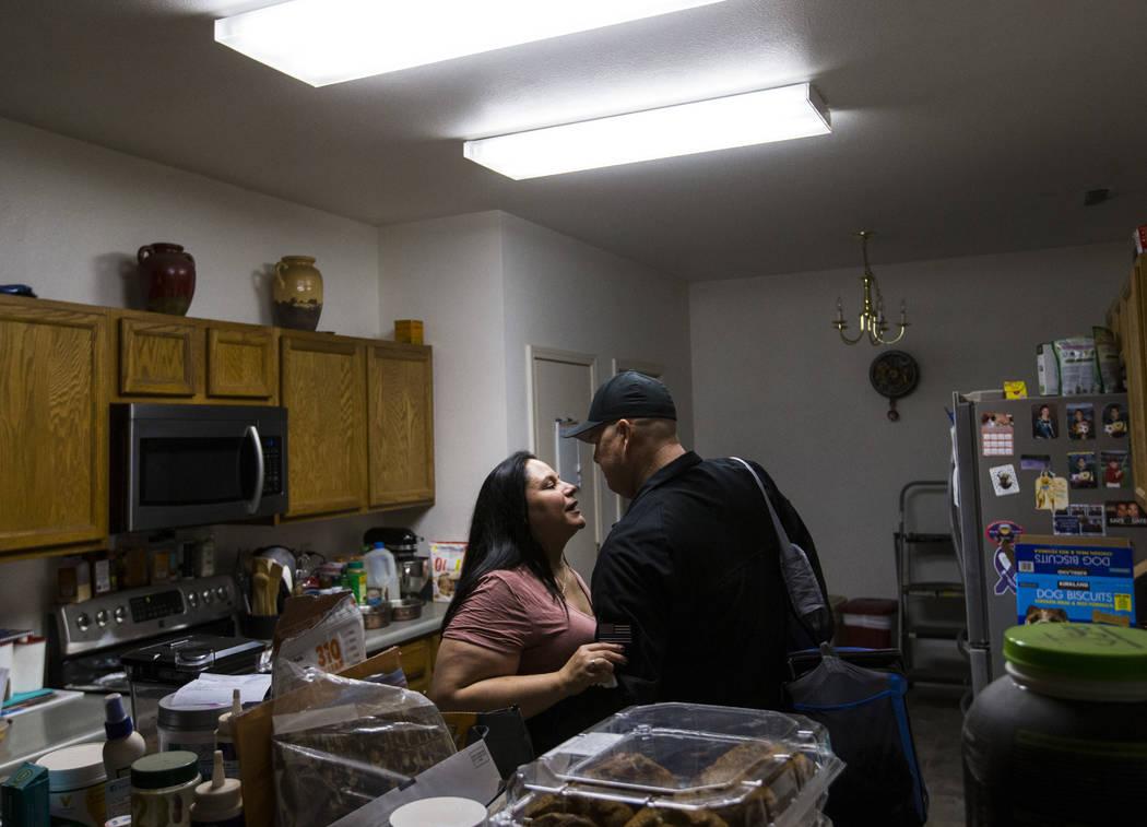 Malinda Baldridge embraces her husband, Dan, as he heads to work for a graveyard shift in Reno on Monday, Sept. 24, 2018. (Chase Stevens/Las Vegas Review-Journal) @csstevensphoto