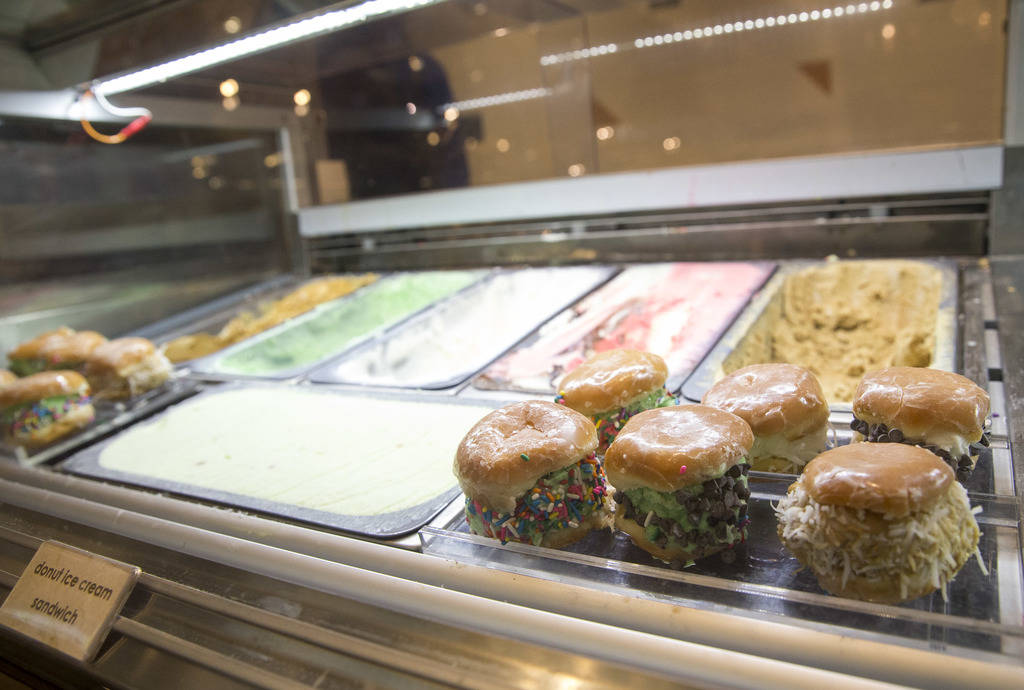 Donut ice cream sandwiches and an assortment of ice cream flavors at the Just Dessert station at the new Feast Buffett at the newly renovated Palace Station hotel-casino in Las Vegas on Friday, Au ...