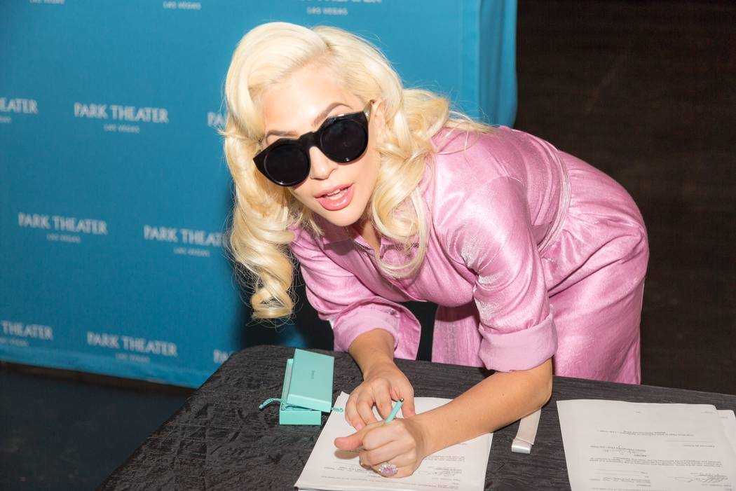 Lady Gaga signs her two-year, multishow contract to perform at The Park Theater on Wednesday, Dec. 19, 2017. (Alex Dolan)