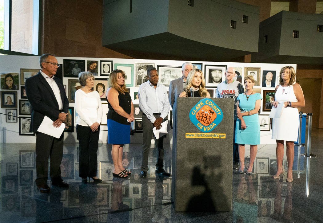 Ellen Abramo, co-organizer for the Las Vegas Portraits Project, speaks to media at the Clark County Government Center in Las Vegas, Monday, Sept. 17, 2018. The exhibit is part of the 1 October Mem ...