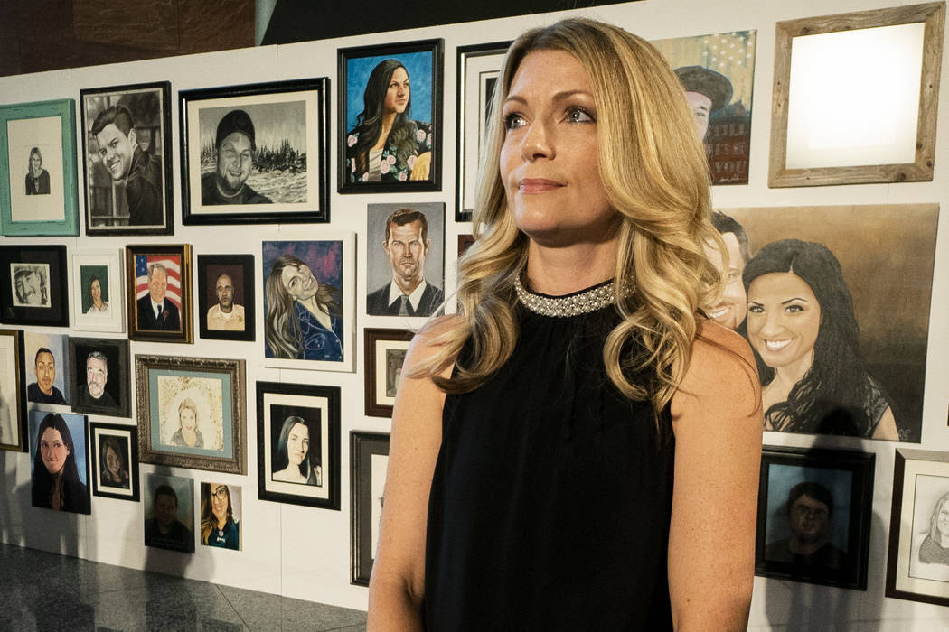Ellen Abramo, co-organizer for the Las Vegas Portraits Project, poses for a photograph at the Clark County Government Center in Las Vegas, Monday, Sept. 17, 2018. The exhibit is part of the 1 Octo ...