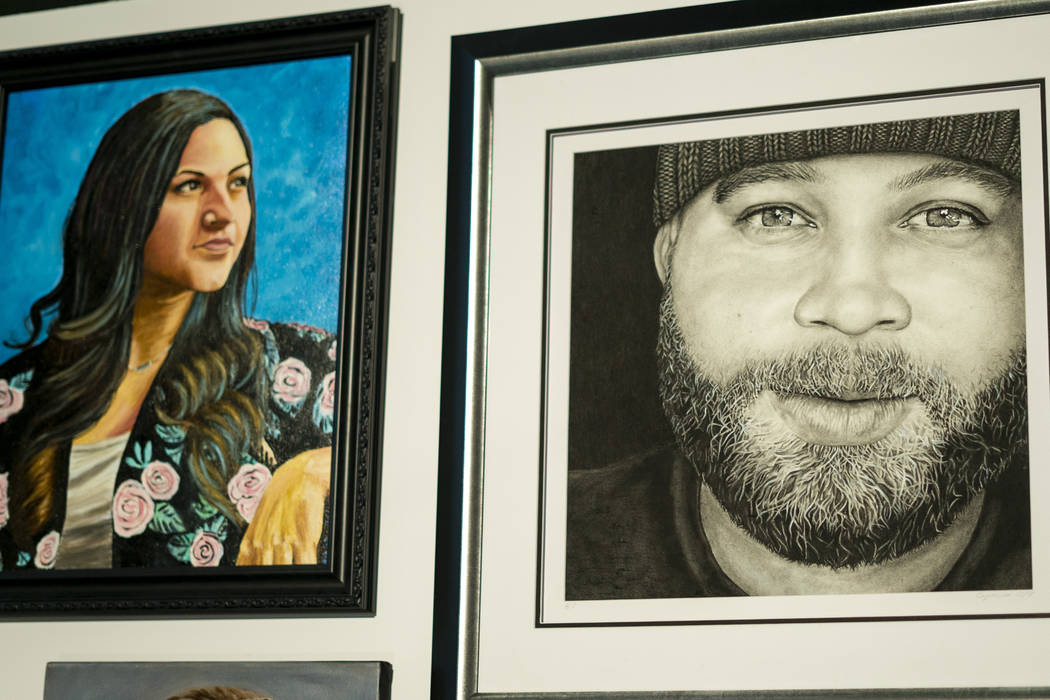 Portraits of victims from the October 1 shooting on display as part of the Las Vegas Portraits Project at the Clark County Government Center in Las Vegas, Monday, Sept. 17, 2018. The exhibit is pa ...