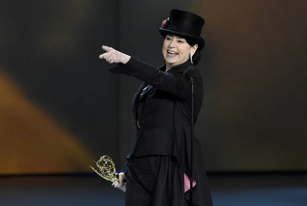 """Amy Sherman-Palladino accepts the award for outstanding writing for a comedy series for """"The Marvelous Mrs. Maisel"""" at the 70th Primetime Emmy Awards on Monday, Sept. 17, 2018, at the Mi ..."""