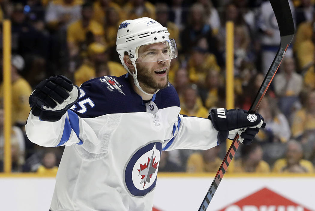 Winnipeg Jets center Paul Stastny celebrates after teammate Tyler Myers scored a goal against the Nashville Predators during the first period in Game 7 of an NHL hockey second-round playoff series ...