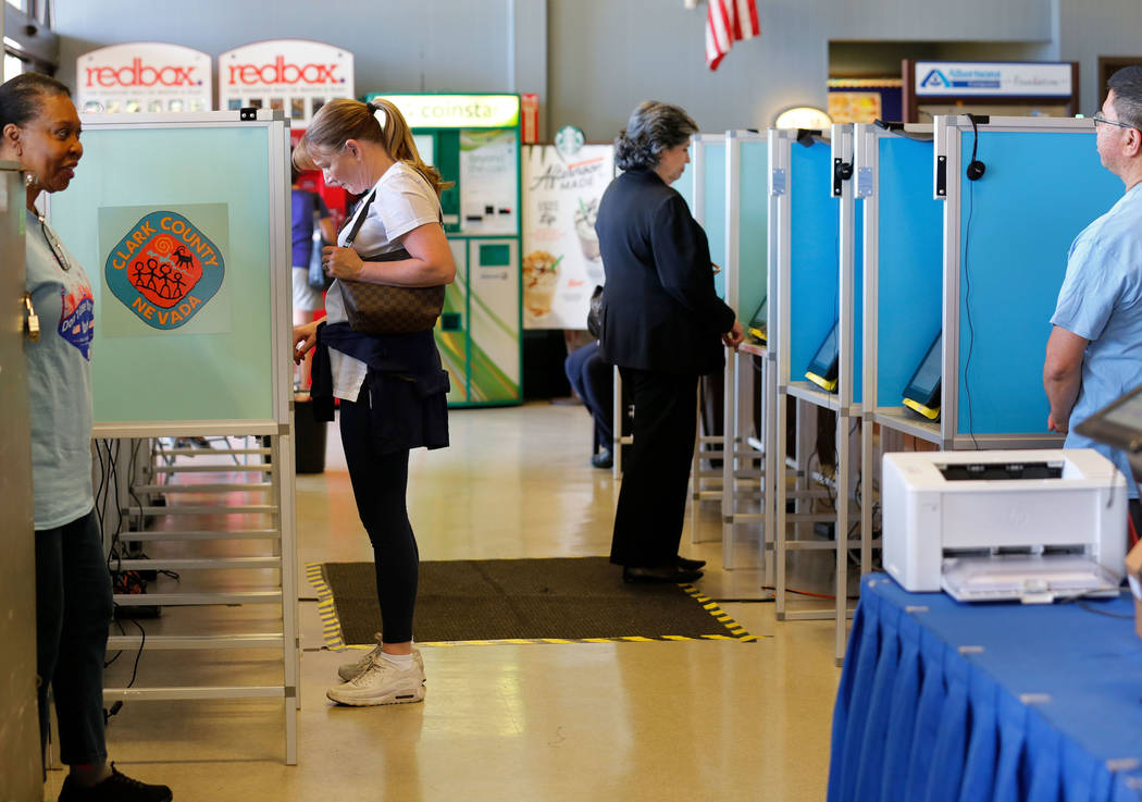 People cast their vote on the first day of early voting for Nevada's primary election at Albertsons at 10250 W. Charleston Blvd. in Las Vegas, Saturday, May 26, 2018. Chitose Suzuki Las Vegas Revi ...