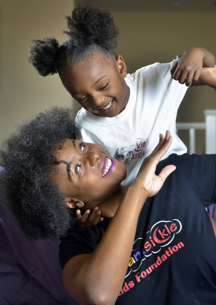 Gina Glass is shown with her daughter Gia Adams, 3, at their home in Las Vegas on Friday, Sept. 14, 2018. Glass founded the Dreamsickle Kids Foundation, which is hosting its first sickle cell awar ...