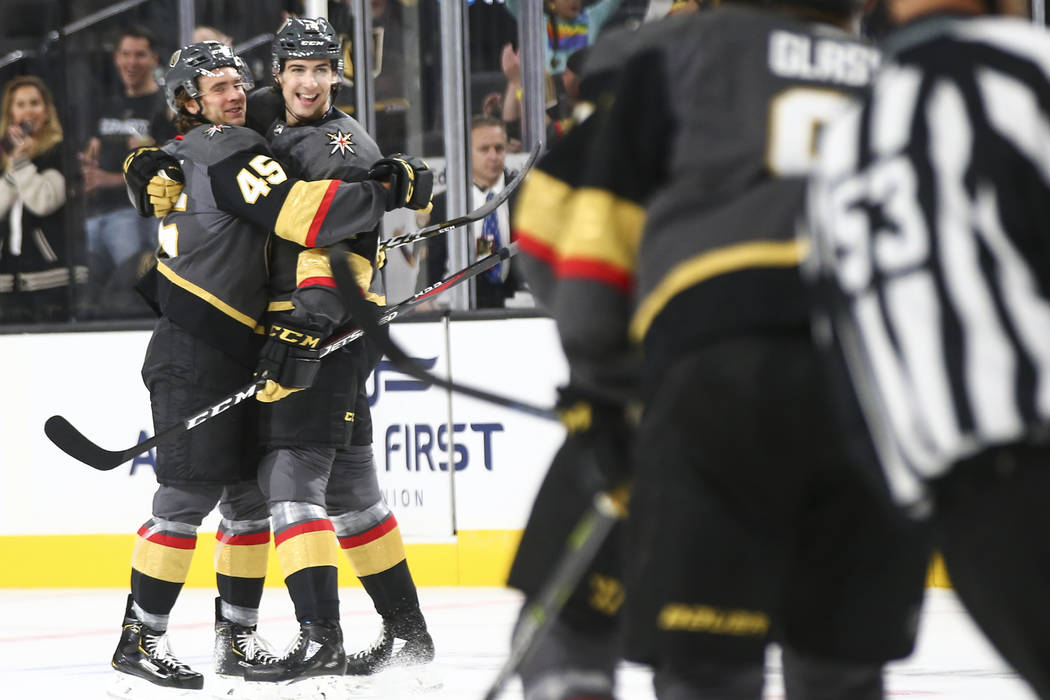 Golden Knights defenseman Jake Bischoff (45) celebrates his goal with Golden Knights defenseman Nicolas Hague (14) during the first period of a preseason NHL hockey game at T-Mobile Arena in Las V ...