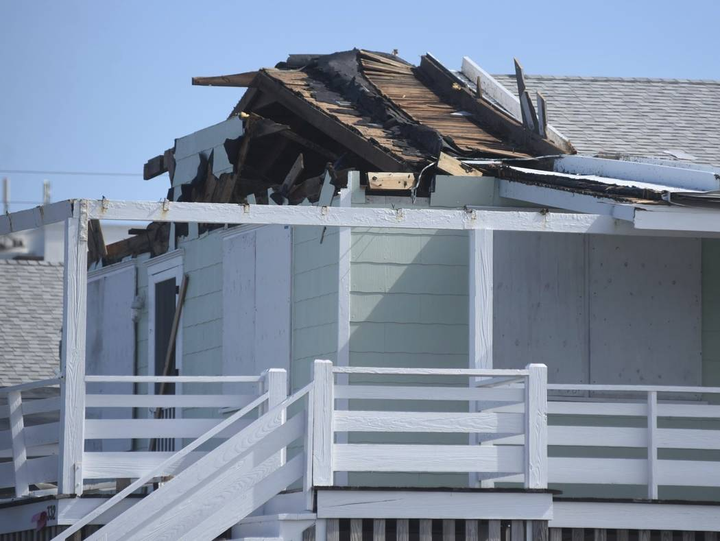 A home along Waynick Blvd. had extensive roof damage in Wrightsville Beach, N.C.,, Tuesday, Sept. 18, 2018, following damage from Hurricane Florence. (Matt Born/The Star-News via AP)
