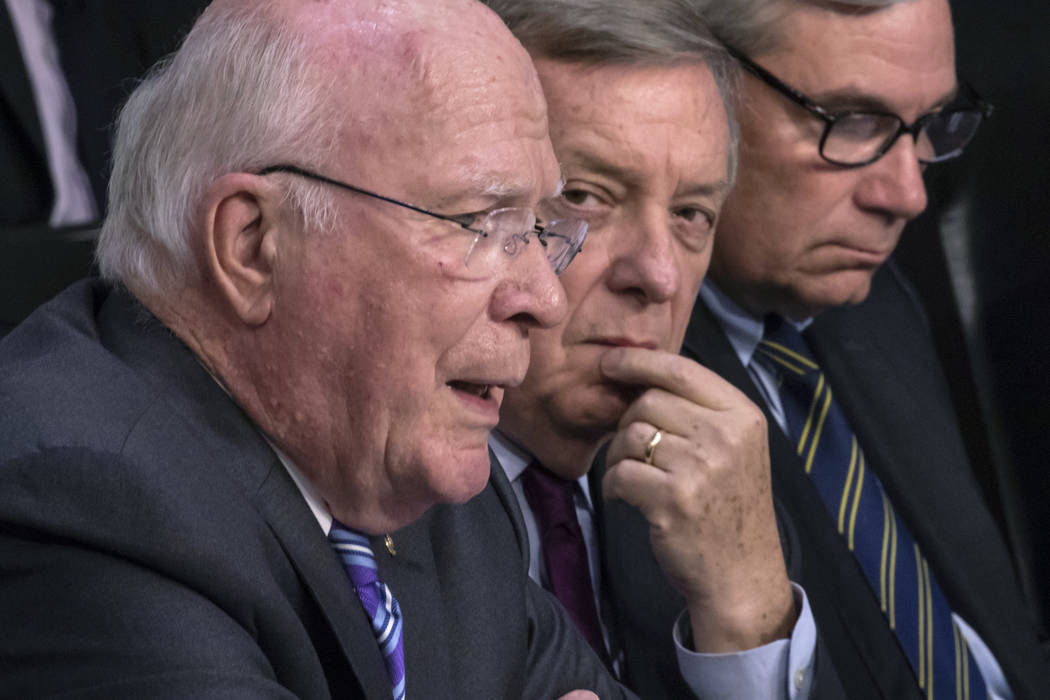 From left, Sen. Patrick Leahy, D-Vt., questions Supreme Court nominee Brett Kavanaugh about his time in the White House, as Sen. Dick Durbin, D-Ill., center and Sen. Sheldon Whitehouse, D-R.I., ri ...