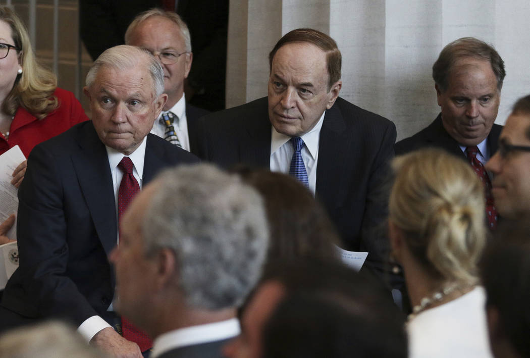 Attorney General Jeff Sessions, left, U.S. Sen. Richard Shelby, R-Ala., and U.S. Sen. Doug Jones, D-Ala. listen during the dedication ceremony for the U.S. Courthouse for the Southern District of ...