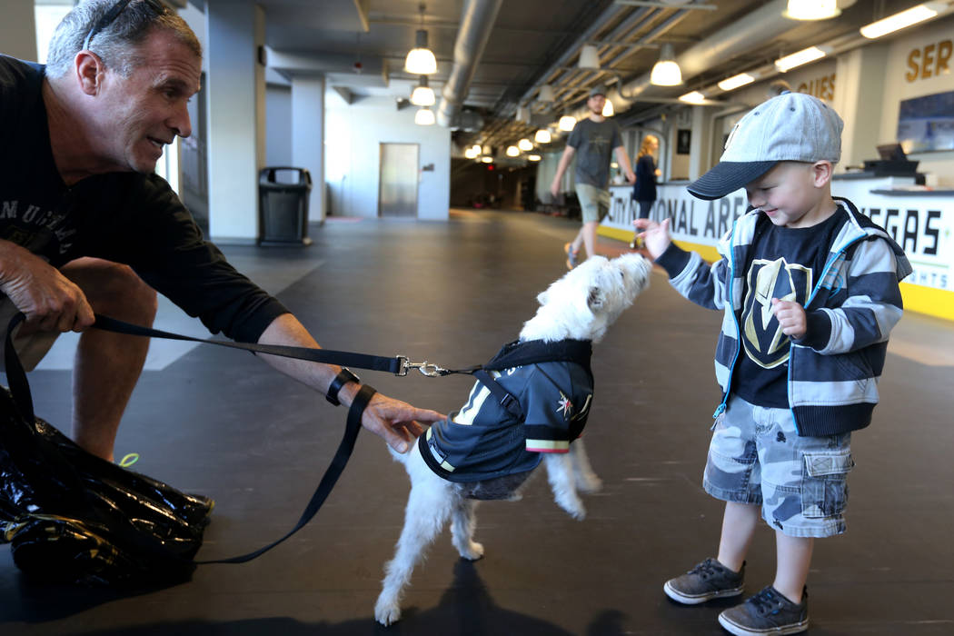 Bark-Andre Furry and his owner Rick Williams say hello to 3-year-old Griffin Schwarz of Las Vegas before Vegas Golden Knights practice at City National Arena in Las Vegas Wednesday, May 9, 2018. K ...