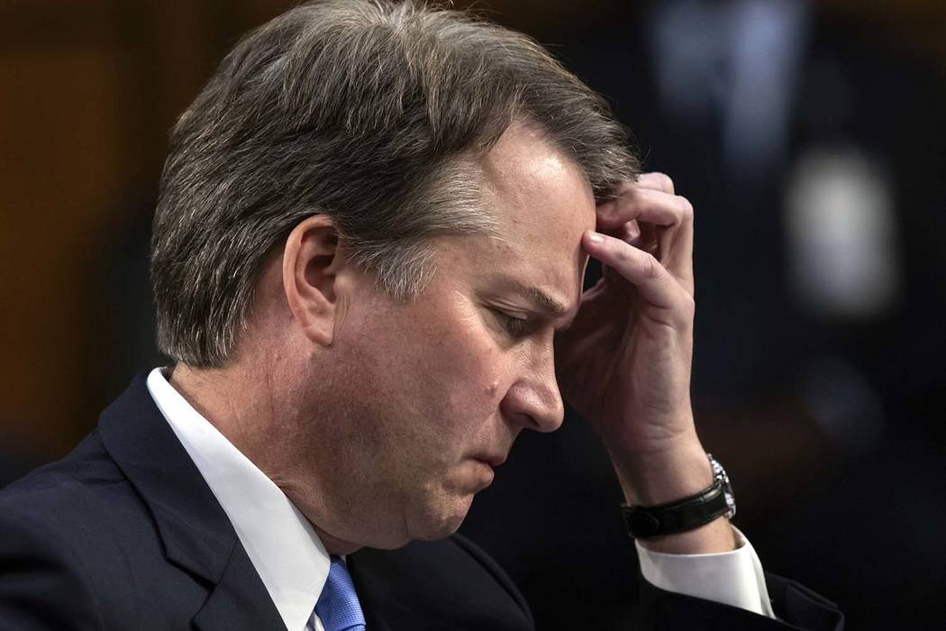 Supreme Court nominee Brett Kavanaugh waits to testify before the Senate Judiciary Committee for the third day of his confirmation hearing, on Capitol Hill in Washington on Sept. 6. (AP Photo/J. S ...