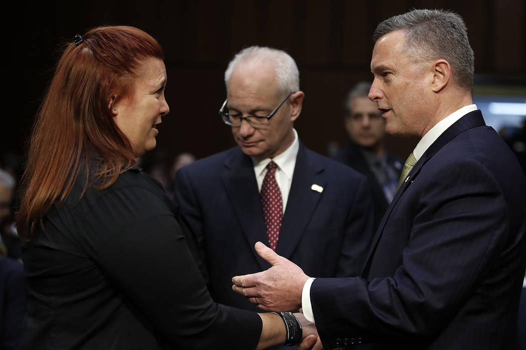 Heather Gooze, Las Vegas shooting witness, and Thomas Brandon, acting director of the Bureau of Alcohol, Tobacco, Firearms, and Explosives, right, talk before they testify during a Senate Judiciar ...