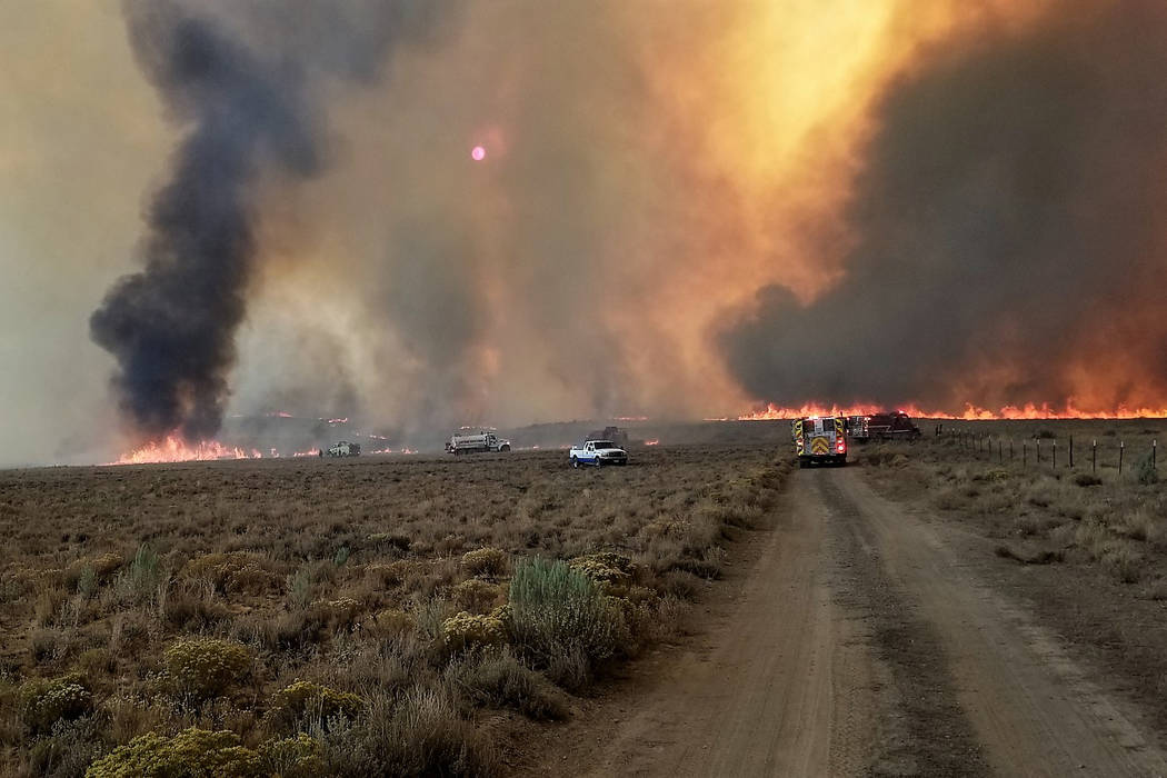 Fire crews battle the South Sugarloaf Fire in Elko County. The fire burned through Nevada's newest conservation easement on the Wildhorse Ranch before it was brought under control. (Rocky Mountain ...