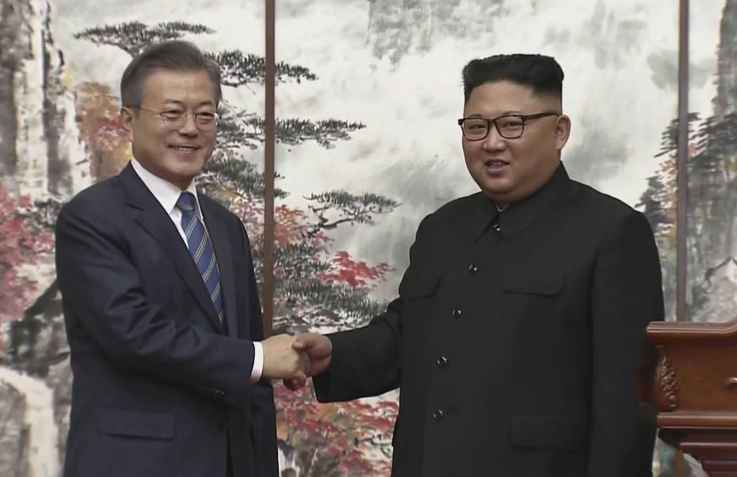 In this image made from video provided by Korea Broadcasting System (KBS), North Korean leader Kim Jong Un, right, and South Korean President Moon Jae-in shake hands at the end of their joint pre ...