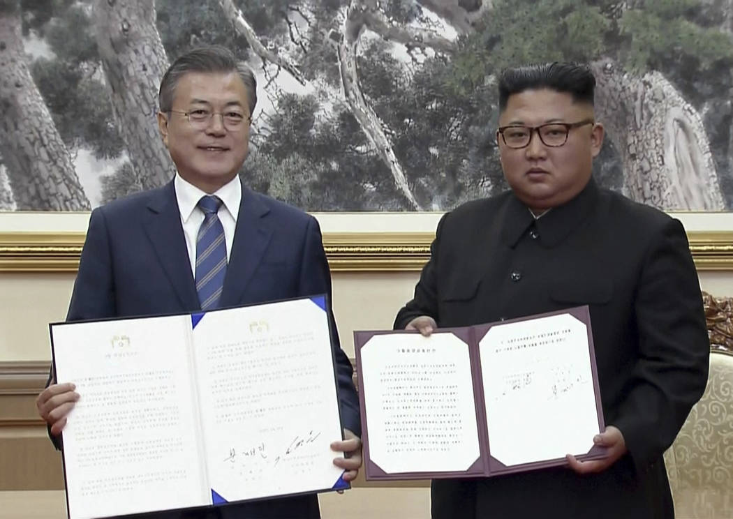In this image made from video provided by Korea Broadcasting System (KBS), South Korean President Moon Jae-in, left, and North Korean leader Kim Jong Un pose after signing documents in Pyongyang, ...