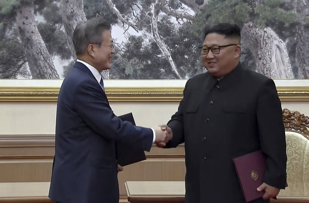 In this image made from video provided by Korea Broadcasting System (KBS), South Korean President Moon Jae-in, left, and North Korean leader Kim Jong Un shake hands after signing documents in Pyo ...