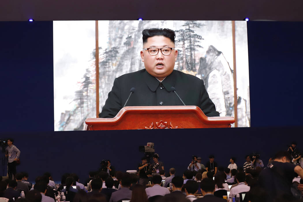 Members of media watch a huge screen showing North Korean leader Kim Jong Un speaks during a joint press conference in Pyongyang, North Korea, at a press center for the inter-Korean summit in Seou ...
